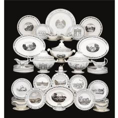 An assembled dinner service of creamware, among others Stone, Coquerel & Le Gros. 19th century comprising three soup terrines, six sauceboats, two mustard pots, circa 107 dinner plates, eight smaller plates, 23 soup plates, five oval serving dishes varying in size and six circular serving dishes varying in size, all decorated in grey with views of palaces and monuments in France, England and German speaking Europe, the borders and rims formed by fruit bearing vines, oak leaves and swags of…