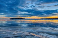Looking across the Moose River on a warm 2015 December 24th. Clouds reflected in the water on the ice. HDR efx balanced.