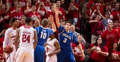 Creighton's Doug McDermott, right, high-fives teammate Grant Gibbs after drawing a foul in the first half against Nebraska on Dec. 6, 2012.  By: REBECCA S. GRATZ/THE WORLD-HERALD