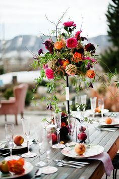 Bright floral arrangements with fruit. Really beautiful.