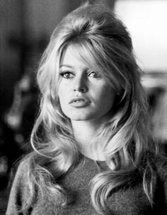 Photograph of Brigette Bardot. Not only does her make-up epitomise the 60's but it also highlights her best features- sultry but sweet.