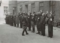 """Jewish engineers are arrested during the Warsaw Uprising. The photo was included in the report by Waffen SS and Police General Stroop, who suppressed the uprising, to Heinrich Himmler. The original caption reads: """"The Jewish department heads of the armament firm Brauer""""."""