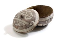 Chalk patterned gourd pot from Nigeria which dates from 1900 – 1917 which was used for storing and serving food. The rind has been hollowed out and chalk has been used to highlight these hollows in the pattern of a crocodile. Charles Partridge Collection, World Collection, Ipswich.