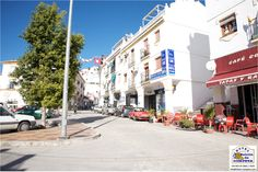 Main Parking Place on the Left and some Bars and Banks on the Right, Main Entrance of Competa - El Parking principal a la izquierda y Bares y Bancos a la derecha, entrada principal de Competa