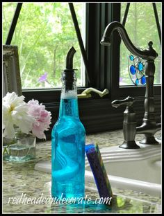 use a pretty bottle and a spout to store dishsoap--thinned to use easier---so much prettier than the plastic bottle...
