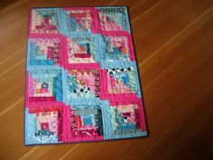 sunshine and shadows log cabin quilt