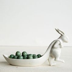Our White Stoneware Rabbit Pulling Leaf Dish is an adorable addition to your spring decor. Visit Antique Farmhouse for more rabbit decor and stoneware dishes.