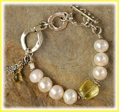 ~SunShine... Top quality lemon quartz in a step faceted nugget and briolette, surrounded by large Freshwater Pearls.... and handcrafted sterling silver. Bracelet measures...........slightly over 7.5 inches fits a 6.5 inch wrist perfect. An Original Artisan Bracelet by Cathy Dailey