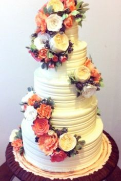 Refined Rustic Wedding Cake. This wedding cake traveled out to the Hamptons for autunm nuptials.  The tailored combed buttercream keeps the look refined, allowing the sugar flowers and tree bark base to create the rustic feel. Photo by Sugar Flower Cake Shop. www.sugarflowercakeshop.com