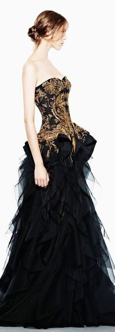 This gown has cool unique styling with the all black base, varying levels and layers of tulle on the bottom, and metallic gold embellishments on the bodice. I wish the website had more details about where to get it!