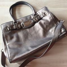 """Michael Kors Large Chain Hamilton Tote Handbag Bag Metallic gray. Large Hamilton bag. Good condition. Some marks throughout. I have not tried to remove them. Both handles and chain embellished shoulder strap. Silver hardware. Tons of storage! 14.5""""X11""""x5"""" strap drop 16"""" handle 6"""". Michael Kors Bags Totes"""