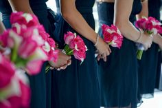 Bright pink bridesmaid bouquet with navy blue dresses