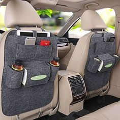 What a brilliant idea!! I stumbled across this image in Pinterest and had to share. I feel like every family car could benefit from one of these multi purpose back seat car hangers (including my own)!