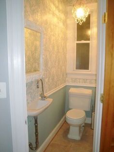 Tiny powder room idea: wall paper, chair rail molding & chandelier! Add bright colors and voila!