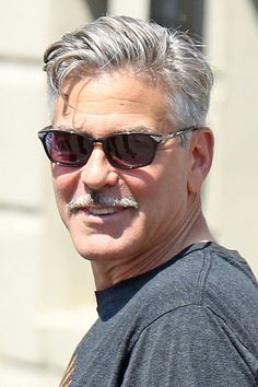 A number of scruff-chic stars are trying to revive this retro motif, but it carries serious baggage. Mustache Men, Moustache, Middle Aged Man, All Hairstyles, George Clooney, Interesting Faces, Attractive Men, Good Looking Men, Haircuts For Men