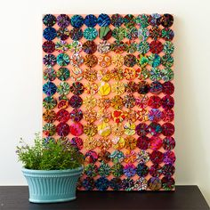 A colorful and creative piece of artwork makes the perfect unique Christmas gift for anyone in your life: http://www.bhg.com/christmas/crafts/cute-craft-christmas-gifts/?socsrc=bhgpin121114fabricyoyoart&page=4