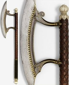 Indian (Chota Nagpur) tabar (axe) with gold koftgari decorations on the blade and intricately carveds haft. , early 19th century. The Royal Armouries at Leeds.