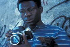 Ref: City of God - love the light, textured wall, camera, color, low-angle - Great Close-up