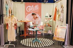 Colette Patterns Display at the Quilt Market are so beautiful! I wish I could have seen them in person. Maybe next year- Craft Fair Displays, Store Displays, Window Displays, Display Ideas, Bazaar Booth, Catering Design, Colette Patterns, Store Layout, Booth Design
