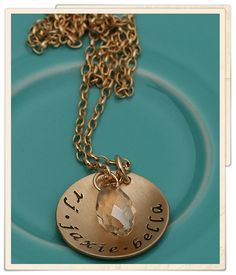 """golden names and a crystal  A gold-filled 1"""" charm is handstamped with your custom names, a date or words around the edge in your favorite font. The charm is then slightly cupped. A beatiful champagne swaroski crystal hangs alongside the charm- subtle, but adds just the right amount of sparkle.  Hung on a gold-filled chain. Looks perfect with our golden teardrop briolettes! $78"""