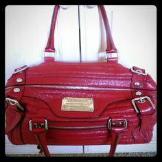 """Authentic Dolce & Gabbana Handbag miss easy way Beautiful Dolce & Gabbana Red Handbag ..Silver accents ..Top unzips from side to side , opens wide ...Beige lining has almost no marks , Inside zipper (7.5"""") and inside pocket (4"""") Fits over shoulder and under arm nicely.Shinny ....Dust Bag Included and Shoulder strap ..one small mark on top and small flaw near plate ...Comes from smoke free home Bought at Neiman Marcus for around $2200 Bag Lenght:13"""" ..Strap drop 8"""" ..Depth 8.5"""" ..height 8""""…"""