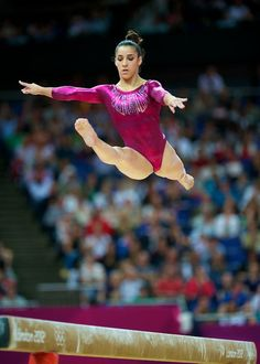Aly Raisman 4 feet above the 4-inch wide beam.