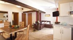 These modern and cosy apartments offer a sunny and quiet location on a south-facing slope right in the centre of Mathon near Ischgl. Cosy Apartment, Ski, Modern, Table, Furniture, Home Decor, Homemade Home Decor, Skiing, Mesas