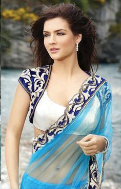 Buy Designer Sea Blue Net Saree With Stylish Blouse by Casa Joya online in India at best price.ook pretty and alluring in this turquoise net saree. The color is unique and it makes the saree all the Indian Blouse Designs, Blouse Back Neck Designs, Saree Blouse Designs, Indian Dresses, Indian Outfits, Collection Eid, Sari Bluse, Latest Saree Blouse, Indische Sarees
