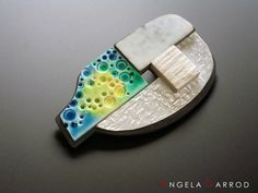 """Opposites No 5 - Brooch """" Ceramano """". This brooch combines ceramic and stone effects with real metal for contrast."""