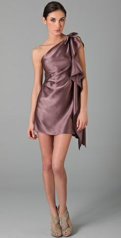 Love this one, obviously a bit longer, and maybe a diff fabric.  This one would show sweat pretty badly!