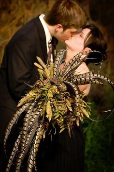 Natural bouquet of lotus pods, millet, nandina berry, wheat, and pheasant feathers