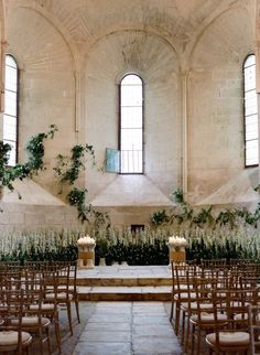 This 12th century chapel was the perfect venue for a romantic, intimate yet grand wedding ceremony in Burgundy. Madame Artisan Fleuriste decorated the altar with lush greens and white to make it seem as if a secret garden had magically blossomed. Image: Joel Serrato #feteinfrance #destinationweddingfrance