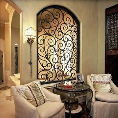 If you are having difficulty making a decision about a home decorating theme, tuscan style is a great home decorating idea. Many homeowners are attracted to the tuscan style because it combines sub… Mediterranean Living Rooms, Mediterranean Decor, Mediterranean Architecture, Mediterranean Window Treatments, Mediterranean Bathroom, Wrought Iron Wall Decor, Rod Iron Decor, Wrought Iron Security Doors, Wrought Iron Gates