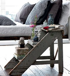 Wooden ladder becomes a nightstand