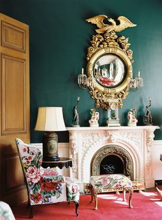 Rose chintz fabric on chair, peacock walls, oversize mirror and gorgeous mantel - The Greenbrier