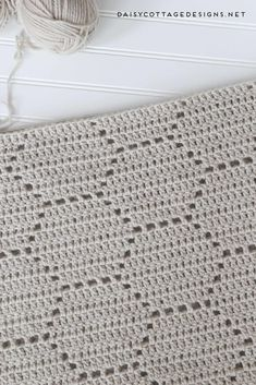 Use this filet crochet pattern to create a beautiful honeycomb blanket. This easy crochet pattern works up quickly and yields gorgeous results. #CrochetPatterns