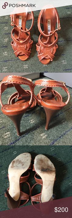 Manolo Blahnik sandals size 38.5 I'm selling a pair of Manolo Blahnik sandals that were purchased from Barneys New York in 2013. The colors are brown and orange and they are absolutely beautiful. They are in good condition but show signs of wear. The original price was $795. I still have the box and will ship it along. Size is 38.5. Manolo Blahnik Shoes Sandals