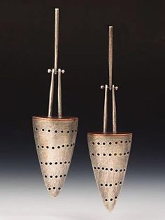 LIke the articulation of the hooks.  Earrings | Baharal Gnida. 'Perforated Cone' Sterling (patina), copper