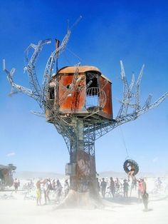 The Steampunk Tree House is a 30-foot-tall interactive work of art first exhibited at Burning Man. It is made of recycled wood and metal, and outfitted with steam pipes, which can exude puffs of steam when needed. There are solar panels included, which power LED lights