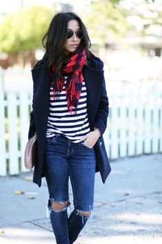 Wear a Gap striped tee with a cozy patterned scarf for a fresh winter look. Top off the outfit with a classic peacoat. We love how blogger Crystalin Marie pulls together this chic ensemble.