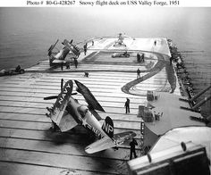 USS Valley Forge: Crewmen use flight deck tractors with power brooms to sweep snow from the carrier's flight deck, during operations off Korea, circa early 1951. Photo is dated 8 May 1951, but Valley Forge ended her second Korean War deployment in late March of that year.