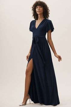 Unbelievably comfy and oh-so-elegant, this jersey maxi dress features a sexy plunge neckline, flutter sleeves, and a deep front slit. A waist-defining bow completes the look.Only available at BHLDN Light Blue Bridesmaid Dresses, Navy Bridesmaid Dresses, Blue Bridesmaids, Bridesmaid Ideas, Bhldn Wedding Dress, Wedding Dresses, Thing 1, Different Dresses, Ladies Dress Design