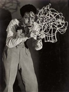 Jean Cocteau sculpting his own head in wire, ca 1926, Man Ray.