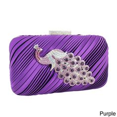 Add glitz and glamour to your outfit with this Jacki Design Evening Cluth. Available in four bright and bold color options with glimmering rhinestones and a gorgeous peacock brooch, this clutch has a