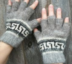 Alpaca fingerless gloves. Texting gloves. Kitten. SALE  only  1 in  black with geometric pattern available.. $34.45, via Etsy.