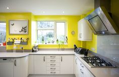 A beautiful White Gloss Curved Kitchen which has been brightened up with sunny yellow walls! German Kitchen, Bespoke Kitchens, Yellow Walls, Kitchen Design, Kitchen Cabinets, Table, Furniture, Beautiful, Home Decor