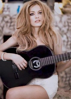 Chanel guitar... looks like mom.. ohhh a few years ago.. need a Chanel Guitar to sing some Dylan