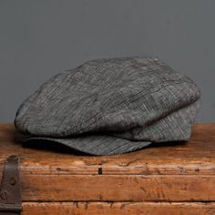 18 Waits | Billy Cap | Linen Charcoal $115  Billy Caps are hand-made in Montreal. Based on a vintage pattern and updated by 18 Waits. Wool is sourced from Woolrich Woolen Mills in Pennsylvania. This Fall/Winter we are offering three variations: charcoal herringbone, light grey herringbone, and brown plaid. Trimmed with a super-soft leather sweatband.