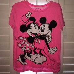 Mickey and Minnie Mouse shirt NWOT Pink, with Mickey and Minnie Mouse. Perfect to wear wherever, including around the disney parks. Super cute. New without tags Disney Tops Tees - Short Sleeve
