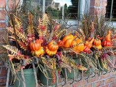 Fall Porch Decorating Idea - DIY Fall Curb Appeal - Good Housekeeping Fill a Window Box  Silk flowers and faux gourds amplify a lonely window with bright colors you can spot from the curb.